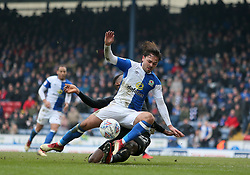 Wigan's Cheyenne Dunkley tackles Blackburn's Bradley Dack