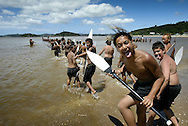 Waka practice on the beach outside Te Tii Marae on the eve of Waitangi Day. February 2004.<br /> Photograph Richard Robinson.<br /> 2004 © New Zealand Herald A Division of APN New Zealand Ltd.<br /> No Reproduction without prior written permission. Contact www.newspix.co.nz to licence photograph.