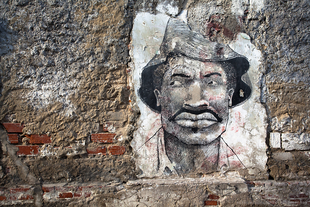 Street art on a crumbling wall of an Afro-American Man in the old town of Cartagena, Colombia.