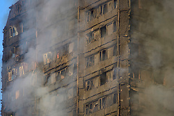 © Licensed to London News Pictures. 14/06/2017. London, UK. Damage to the building at the scene of a huge fire at Grenfell tower block in White City, London. The blaze engulfed the 27-storey building with 200 firefighters attending the scene. There were reports of people trapped in the building. Photo credit: Ben Cawthra/LNP