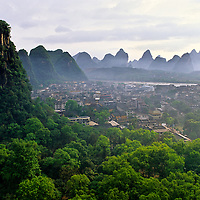 Myriad karst towers surround the misty city of, Yangshuo, Guilin, China