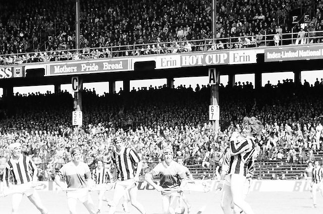 A Kilkenny and Wexford player collide as stands are packed with fans during the All Ireland Senior Leinster Hurling Final Kilkenny v Wexford at Croke Park on the 24th of July 1977. Wexford 3-17 Kilkenny 3-14.