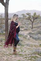 Maternity portraits of a desert woman.