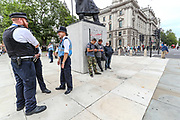 """Three individuals from the far-right political group stand guards beside the Winston Churchill monument outside the Houses of Commons in Parliament Square, central London on Sunday, Aug 16, 2020 - as people called from """"All Black Lives UK"""" carrying banners, placards and flags gather to protest against police brutality outside the Houses of Parliament in London on Sunday, Aug 16, 2020. Black Lives Matter enters the 12th weekend of continuous demonstrations against racial injustice in Britain. (VXP Photo/ Vudi Xhymshiti)"""