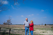 """ANDERSON, AL – MARCH 10, 2014: Debbie and Steve Smith stand on their property in rural Anderson, Alabama, where they frequently played with their grandchildren and their late daughter, Aubrey Wallace Williams. Williams was killed in a fatal car wreck in December 2013. """"We've had to hold each other up,"""" Debbie said. The accident may been related to the recall of the Chevy Cobalt. CREDIT: Bob Miller for The New York Times"""