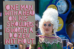 An environmental activist in period costume opposed to the HS2 high-speed rail link restages a historical 1602 visit by Queen Elizabeth I to Dews Farm on 31st July 2020 in Harefield, United Kingdom. Activists tried to retrace the steps of Queen Elizabeth I from St Mary's church to Dews Farm in order to pay their respects to Anne and Ron Ryall, 73 and 72, on the day of their eviction from Dews Farm by HS2 after having spent nine years and their life savings renovating their £1m dream home, but found their path blocked by HS2 fences and security guards.