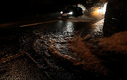 ©Paul Thompson Licensed to London News Pictures. 12/12/2015. Clayton, near Bradford, West Yorkshire. Cars struggling through flooded roads after torrential rain. Photo credit :Paul Thompson/LNP