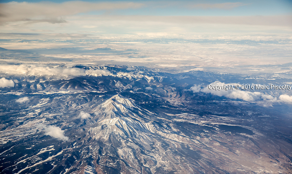 SHOT 1/30/16 8:46:48 AM - Mountains outside of Colorado Springs, Colorado on a commercial flight to Puerto Vallarta, Mexico. (Photo by Marc Piscotty / © 2016)