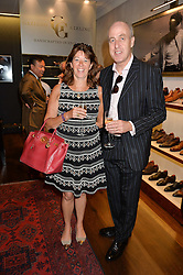 FLORENCE PAUL and DUNCAN McRAE at a party to celebrate the 10th anniversary of Gaziano & Girling's at 39 Savile Row, London on 14th September 2016.