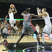 ORLANDO, FL - NOVEMBER 15: Ceasar DeJesus #4 of the UCF Knights drives to the net against Jaheam Cornwall #1, Eric Jamison #2 and L'Hassane Niangane #31 of the Gardner Webb Runnin Bulldogs during a NCAA basketball game at the CFE Arena on November 15, 2017 in Orlando, Florida. (Photo by Alex Menendez/Getty Images) *** Local Caption *** Ceasar DeJesus; Jaheam Cornwall; Eric Jamison; L'Hassane Niangane