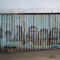 A mural on the border wall at Tijuana depicts people who have been deported from the US.