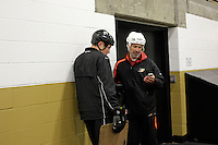 14 December 2012: Scott Niedermayer and Jason Marshall discuss their kids after practice skating on one of the rinks. NHLPA players skated in a Charity Game at The Rinks -Anaheim Ice benefiting the Jr. Ducks Pee Wee AAA team and The Children's Hospital of Orange County.  The players skated 4 on 4 with a standing room only capacity of fans with over 500 tickets sold. The White team won the game 10-6 in a Ducks vs Kings lineup.  The NHL is in its 92nd day of locking out their players.