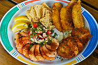 Seafood plate with Key West Pink Shrimp, Conch Ceviche, Fried coconut shrimp and hogfish, Hogfish Bar & Grill, Stock Island, Key West, Florida Keys, Florida USA