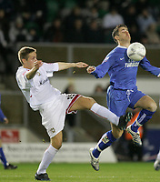 Photo: Marc Atkins.<br /> Milton Keynes Dons v Farsley Celtic. The FA Cup. 21/11/2006. James Knowles (R) of Farsley Celtic chests the ball away from Gareth Edds of MK Dons.
