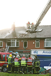 © Licensed to London News Pictures. Manchester, UK 16/05/2012: Twenty five firefighters tackle a blaze at a flat above H&A Tailors on the A34 Kingsway in Levenshulme. Two people were evacuated from the flat and taken to hospital. The main city-centre route was closed in both directions. Photo credit : Joel Goodman/LNP