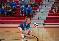 Harper Meehan gets the dig for Gilford during girls varsity Volleyball at Laconia Thursday evening.   (Karen Bobotas Photo/for The Laconia Daily Sun)