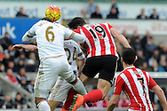 Swansea's Ashley Williams (6) challenges Southampton's Graziano Pelle (19) for a header. Barclays Premier league match, Swansea city v Southampton at the Liberty Stadium in Swansea, South Wales on Saturday 13th February 2016.<br /> pic by  Carl Robertson, Andrew Orchard sports photography.