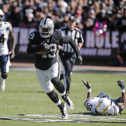 Oct 09 2016 - Oakland U.S. CA - Raiders fullback Jamize Olawale #49 breakaway on a long run during the NFL Football game between San Diego Chargers and the Oakland Raiders 34-31 win at O.co Coliseum Stadium Oakland Calif. Thurman James