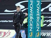 2004/05 Powergen Cup, Saracens vs Newcastle Falcons, 19.12.2004, Watford, ENGLAND:<br /> Newcastle coach Rob Andrew watches his squard 'warm up' before their opening game in defence of the Powergen Cup. <br /> Watford, Hertfordshire, England, UK., 19th December 2004, [Mandatory Credit: Peter Spurrier],