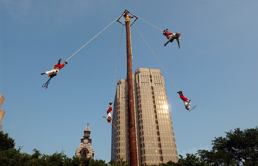 NE6/22/06 2Flyers<br /> ML0277E<br /> Los Voladores de Papantla perform during the Int'l Festival of Arts & Ideas on the New Haven Green. Photo by Mara Lavitt