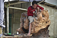 A man is working on a sculpture in Sapa surroundings, Lao Cai province, North Vietnam.