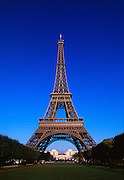 Eiffel Tower and park with blue sky.