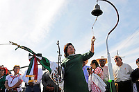 """Honorary Consul Blanca Estela Zarazua rings a replica of Father Miguel Hidalgo's church bell, representing the beginning of the Mexican revolution against Spain more than 200 years ago. """"El Grito,"""" or """"The Cry of Independence"""" followed the ringing of the bell, with Sunday's crowds along East Alisal in Salinas shouting """"Viva Mexico."""""""