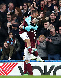 West Ham United's Javier Hernandez (left) celebrates scoring his side's first goal of the game with team-mate Marko Arnautovic