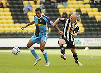 Photo: Leigh Quinnell.<br /> Notts County v Wycombe Wanderers. Coca Cola League 2. 12/08/2006. Wycombes Kevin Betsy keeps the ball from Notts Countys Andy Parkinson.