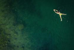 THEMENBILD - eine Frau schwimmt im Zeller See, aufgenommen am 30. Juni 2019 in Zell am See, Österreich // a woman swims in the Zeller lake, Zell am See, Austria on 2019/06/30. EXPA Pictures © 2019, PhotoCredit: EXPA/ JFK