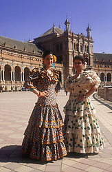 Plaza de Espana; Seville; with two women wearing traditional flamenco dresses,