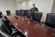 Kevin Pesko, President and CEO of the Bank of Belleville, shows the new board of directors meeting room at the bank's new site at 215 South Illinos Street, and explains how lthe room has been prepped for large screen monitors and other high-tech tools.