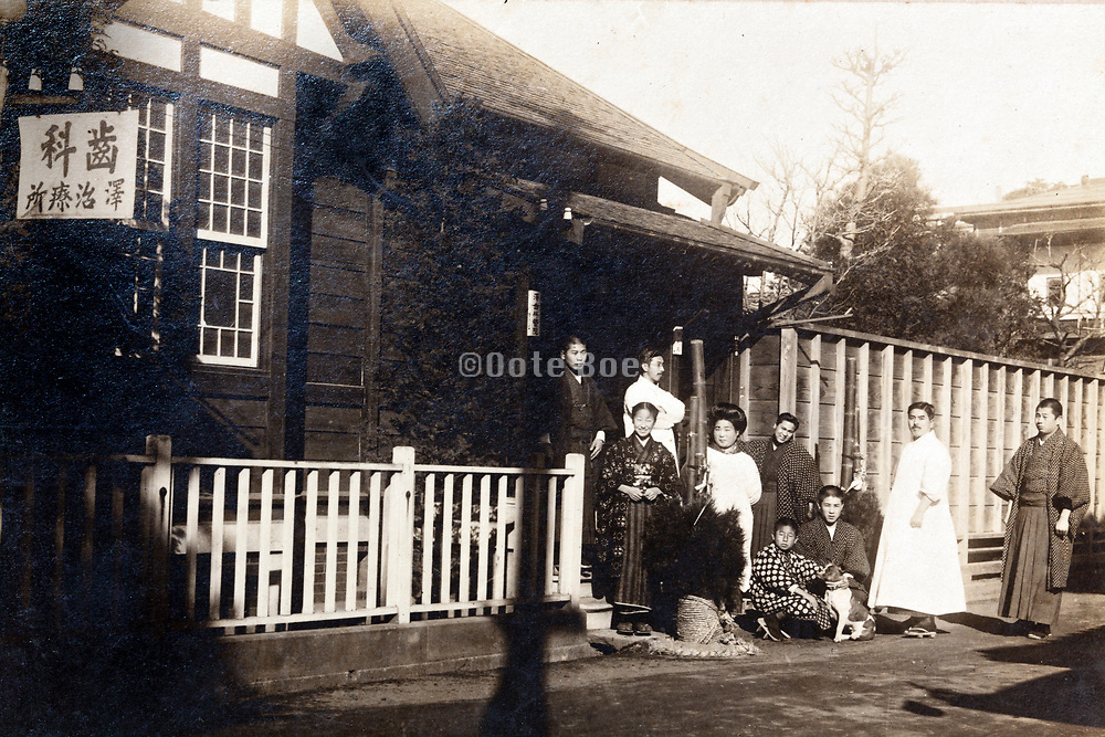 people standing in front of dentist office during the New Year celebration holidays Japan 1920s