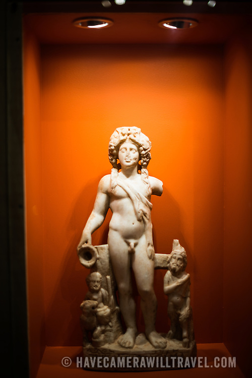 Statuette of Dionysos, thought to date to the 2nd or 3rd century AD, on display in the main building of the Istanbul Archaeology Museums. The Istanbul Archaeology Museums, housed in three buildings in what was originally the gardens of the Topkapi Palace in Istanbul, Turkey, holds over 1 million artifacts relating to Islamic art, historical archeology of the Middle East and Europe (as well as Turkey), and a building devoted to the ancient orient.