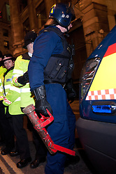 © licensed to London News Pictures. London, UK. 27/01/12. Police enter with Battering ram. Protestors cleared from new site in the City of London. The 'Bank of Ideas' group, who had occupied the disused Bank of Iraq building at 7-10 Leadenhall, are cleared after it emerged the building is a diplomatic premises under Section 9 of the 1977 Criminal Law Act. Fire services cleared the street after finding a strong smell of Diesel upon entry to the premises and cleared. Photo credit: Jules Mattsson/LNP