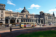 The Retiro train station FCG Mitre on the Plaza San Martin Square renamed Plaza de la Fuerza Aerea or Plaza Fuerza Retiro. City bus passing. Buenos Aires Argentina, South America