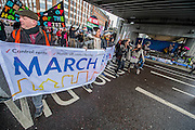 Here passing homeless people under a bridge at the top of Bishopsgate in the City. People marched from South London and East London to City Hall to demand better homes for Londoners and an end to the housing crisis. Demands included rent controls, affordable and secure homes for all, an end to the Bedroom Tax and welfare caps and the building of new council houses. The event was called by Defend Council Housing and  South London People's Assembly. And the East London route started at Parish Church of St. Leonard, Shoreditch, London, United Kingdom. 31 Jan 2015.Guy Bell, 07771 786236, guy@gbphotos.com