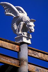 Stock photo of a gargoyle statue perched atop a roof in downtown Houston, Texas
