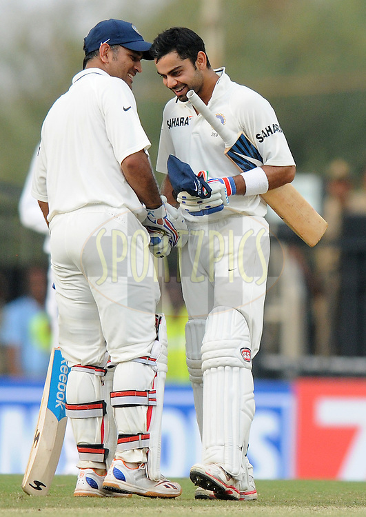 MS Dhoni captain of India congratulates teammate Virat Kohli of India as the latter scores a century during day three of the 4th Airtel Test Match between India and England held at VCA ground in Nagpur on the 15th December 2012..Photo by  Pal Pillai/BCCI/SPORTZPICS .