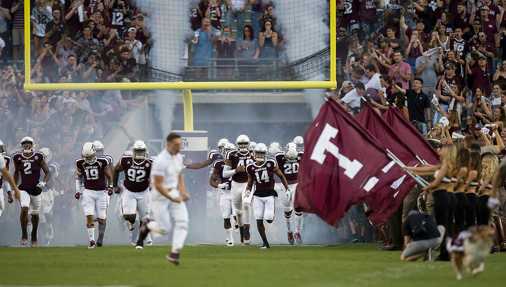 Members of the Texas A&M football team run out of the tunnel before the start of an NCAA college football game against South Carolina Saturday, Sept. 30, 2017, in College Station, Texas. (AP Photo/Sam Craft)