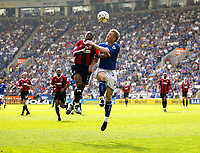 Photo: Scott Heavey.<br />Leicester City v Manchester City. FA Barclaycard Premiership. 24/04/2004.<br />Shaun Wright-Phillips (L0 and Ben Thatcher challenge in the air
