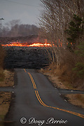 a lava river erupted from Fissure 8 of the Kilauea Volcano east rift zone blocks Leilani Avenue in the quiet residential subdivision of Leilani Estates near Pahoa, Puna District, Hawaii Island, Hawaiian Islands, U.S.A.; the stream of lava is estimated to flow downhill at about 20 mph in this area