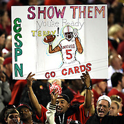 Fans hold up a sign on Louisville Cardinals quarterback Teddy Bridgewater during the NCAA Football Russell Athletic Bowl football game between the Louisville Cardinals and the Miami Hurricanes, at the Florida Citrus Bowl on Saturday, December 28, 2013 in Orlando, Florida. Louisville won the game by a score of 36-9. (AP Photo/Alex Menendez)