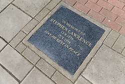 © licensed to London News Pictures. London, UK 24/03/2014. Two men aged 18 and 19 have been arrested after a Stephen Lawrence memorial plaque in Eltham, southeast London was damaged. It is believed that a flowerpot containing flowers was broken and the plaque spat on at place where teenager was murdered. Photo credit: Tolga Akmen/LNP