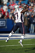 New England Patriots wide receiver Bernard Reedy (17) leaps and catches a pass during pregame warmups before the 2017 NFL week 13 regular season football game against the Buffalo Bills, Sunday, Dec. 3, 2017 in Orchard Park, N.Y. The Patriots won the game 23-3. (©Paul Anthony Spinelli)