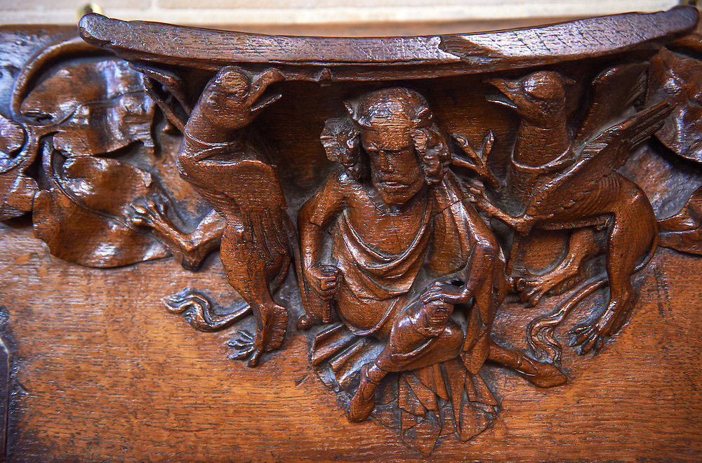 """Misericords of the medieval Wells Cathedral built in the Early English Gothic style in 1175, Wells Somerset, England . Its Gothic architecture is mostly in Early English style of the late 12th – early 13th centuries. Building began about 1175 at the east end with the choir. Historian John Harvey sees it as Europe's first truly Gothic structure. Its Early English front with 300 sculpted figures, is seen as a """"supreme triumph of the combined plastic arts in England"""".<br /> <br /> Visit our MEDIEVAL PHOTO COLLECTIONS for more   photos  to download or buy as prints https://funkystock.photoshelter.com/gallery-collection/Medieval-Middle-Ages-Historic-Places-Arcaeological-Sites-Pictures-Images-of/C0000B5ZA54_WD0s"""