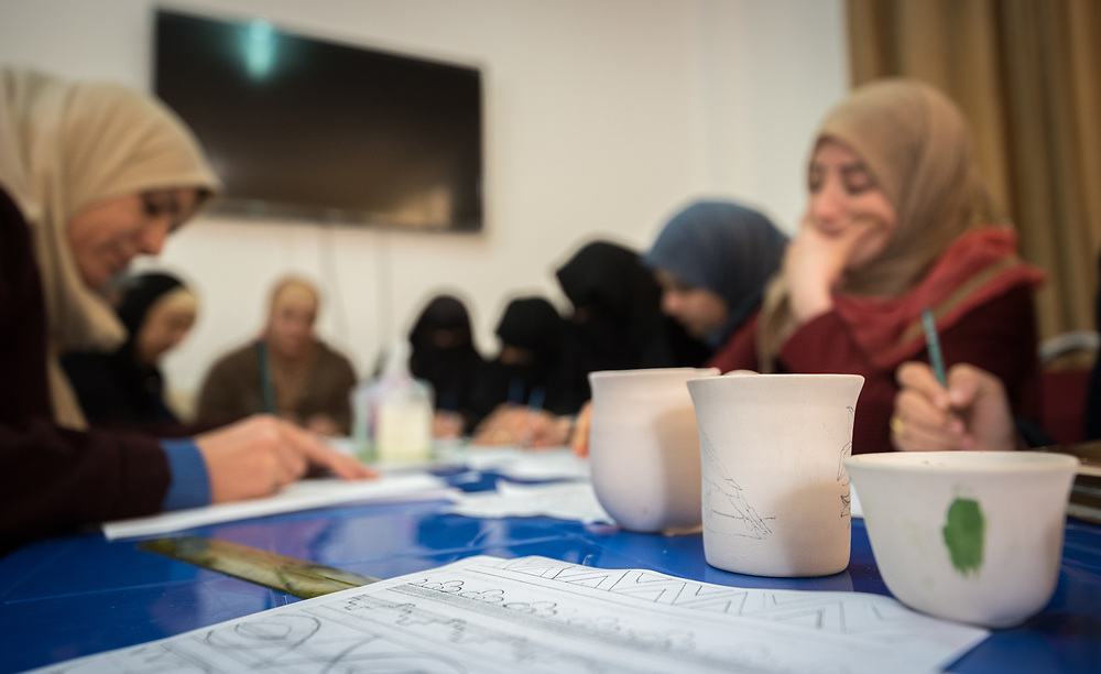 17 February 2020, Zarqa, Jordan: Women draw up their designs during ceramics class held by the Lutheran World Federation at the Zarqa Ladies Association, one of some 200 Community-Based Organizations in Zarqa. Through a variety of activities, the Lutheran World Federation serves to offer psychosocial support and strengthen social cohesion between Syrian, Iraqi and other refugees in Jordan and their host communities.