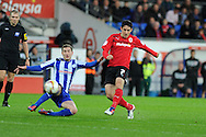 Peter Whittingham of Cardiff city ® hits a shot wide of goal. NPower championship, Cardiff city v Sheffield Wednesday at the Cardiff city Stadium in Cardiff on Sunday 2nd Dec 2012. pic by Andrew Orchard, Andrew Orchard sports photography,