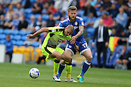 Aron Gunnarsson of Cardiff city ® challenges Joey Van Den Berg of Reading (l).EFL Skybet championship match, Cardiff city v Reading at the Cardiff city stadium in Cardiff, South Wales on Saturday 27th August 2016.<br /> pic by Andrew Orchard, Andrew Orchard sports photography.