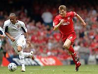 Photo: Daniel Hambury.<br />Liverpool v West Ham United. The FA Cup Final. 13/05/2006.<br />Liverpool's Steven Gerrard and West Ham's Danny Gabidon chase the ball.